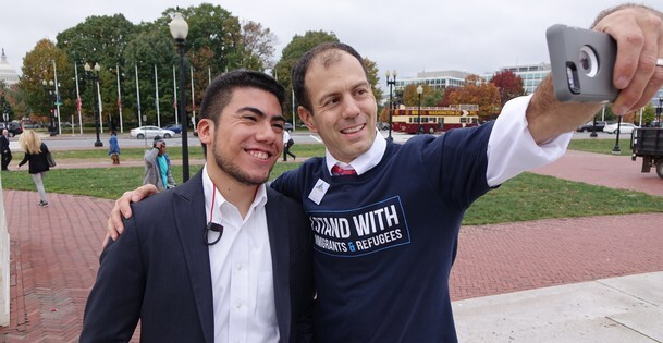 Chris Kerr (right) is seen taking a selfie with Jose, a DACA recipient who is very involved in immigration rights activism.